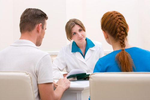 Physician counseling a couple